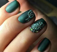 A truly stand out looking rose nail art design. The roses are painted in green nail polish which is also the same as the background. The roses look like they have been embossed which adds more chamr to the design.