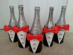 Tuxedo wine bottle centerpieces give a touch of elegance to any ...