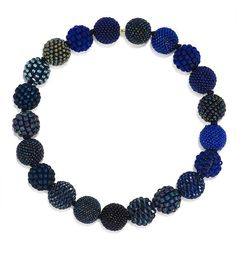 German jewelry artist Axel Russmeyer makes the most amazing necklaces...each bead is handmade.