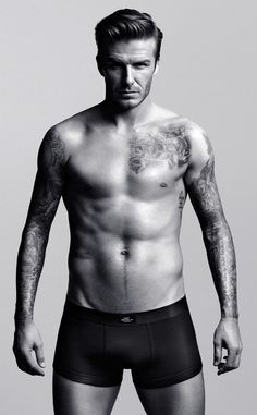 Another H&M Ad from David Beckham Shirtless  David looks like he's demanding we pay attention to his ad...and we're not going to argue with him!