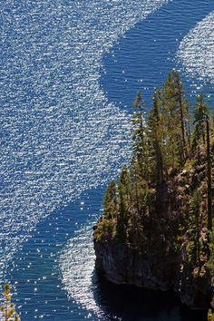 ✯ Wind Streams - Crater Lake National Park, Oregon... Crater Lake is a caldera lake in the western United States, located in south-central Oregon. It is the main feature of Crater Lake National Park and is famous for its deep blue color and water clarity.
