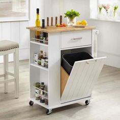 $223.12 · Bring extra storage to your kitchen with the Lima kitchen cart. This cart comes with a pull-out compartment to conceal an 8-gallon trash bin, round cut-outs to safely hold bottles, a knife holder, and drawers to store cutlery and small items. Four casters make this cart easy to move, helping you optimize your available kitchen space. Includes one (1) kitchen cart Pull-out trash bin (liner not included) One (1) drawer for kitchen essentials Three (3) tiered spice rack and to..