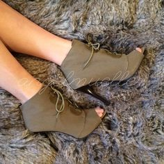 """Green peep toe lace booties This super cute heels are bootie style, the come up the ankle, lace up closure. Small amount of normal wear. Canvas material, super military chic. Length: 10.5"""", width: 3"""", heel height: 4.50"""". Small marks on the heels. Elle Shoes Ankle Boots & Booties"""
