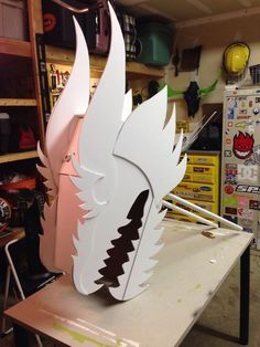 another pinner said.Chinese dragon head built for my wife's classroom. By Todd Van Fleet. Made with cardboard, foam core and lots of hot glue. Painted with spray paint. The handles are PVC so kids can hold it over their head. Diy And Crafts, Crafts For Kids, Arts And Crafts, Paper Crafts, Dragon Mask, Dragon Head, Dragon Project, Chinese New Year Dragon, Make A Dragon