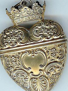 Silver-Gilt Love Token Box -- Elaborate silver betrothal boxes have been a European tradition since medieval times.  This silver and gilt Victorian version is in the form of a locket, opening to contain a special memento.