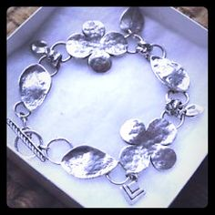 """Vintage Silpada Shamrock Sterling Silver Bracelet Lady Luck is on your side with this gorgeous Celtic inspired oxidized hammered sterling silver bracelet featuring shamrocks, leaves, and Silpada arrowhead charms. Fits up to a 7 & 3/4"""" in wrist and has an adjustable toggle clasp. Vintage retired Silpada design from 2008. Stamped .925 and """"Israel"""" and bears the Silpada arrowhead hallmark. Silpada Jewelry Bracelets"""