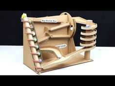 How to make big marble run machine from cardboard. You can make this project at home with your friends. It's so fun and I really love this marble run machine. Cardboard Rolls, Cardboard Playhouse, Cardboard Crafts, Rolling Ball Sculpture, Marble Tracks, Rube Goldberg Machine, Paper Machine, Marble Machine, Cardboard Fireplace