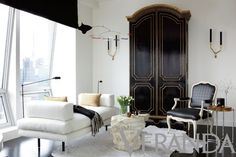 In Good Taste:  Richard Hallberg Design - love the black and white iliivng room and the beautiful black armoire