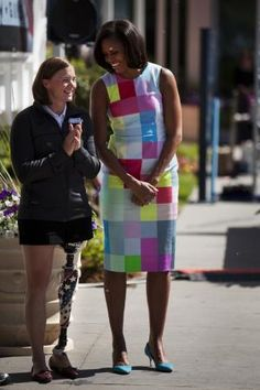 Michelle Obama talks with Melissa Stockwell, the first female amputee from the war in Iraq, during the torch lighting of the 2012 Warrior Games at The Olympic Training Center in Colorado Springs, Colo., April 30. The Warrior Games is a competition between wounded warriors from all military branches and includes swimming, track and field, cycling, shooting, archery, sitting volleyball, and wheelchair basketball and run through May 5.