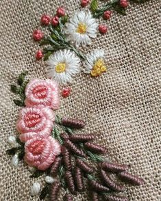 Beautifully stitched bullion roses, and lazy daisies.