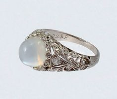 An American Art Deco moonstone diamond and platinum ring by Black Starr & Frost from Scarab Antiques