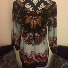NICOLE MILLERBEAUTIFUL BOHO BLOUSE SZ16 Beautiful print, sutache trim around neck. Peasant style elastic 3/4 sleeves. Excellent condition. Worn a few times only. All offers considered Nicole by Nicole Miller Tops Blouses