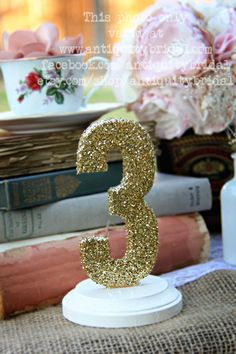 Me:-) Glittered table numbers