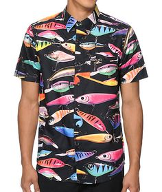 Stand out like never before with an all-over vibrant multicolor fishing lure print with a button up left chest pocket for added style.