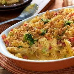 Easy Mac & Cheese Veggie Chicken Casserole Recipe with Country Crock® Spread, 2% reduced-fat milk, rotini, cooked chicken, frozen vegetables, low-fat cheddar cheese, plain dry bread crumb, parmesan cheese