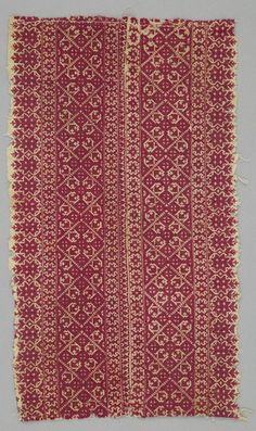 Object Name: Cushion Cover Local Name: terz del ghorza Place Made: Africa: North Africa, Morocco, Fez Period: Late 19th to 20th century Date: 1890 - 1920 Dimensions: L 40 cm x W 23 cm Materials: Cotton; silk Techniques: Plain woven; embroidered