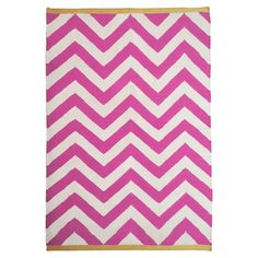 Featuring a classic chevron pattern in vibrant fuchsia and yellow tones, this 100% wool rug brings geometry and texture to your living room or hallway scheme...