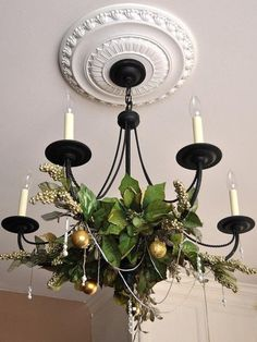 Christmas Chandelier..OR use a touch of sprigs and/or fresh strung garland using the colors of the season. EXAMPLE_EASTER: Drain eggs, decorate  and string them. Sporadically place some pretty silk floral's amongst them. Sooo much prettier than cheap tinsel garland.