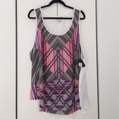 Ava & Viv Tribal Tank Brand new with tags. From Target. Colors are pink purple gray and white. Size 3x. Rayon, polyester, spandex. Ava & Viv Tops Tank Tops
