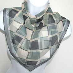Unisex styling, perfect as an ascot, handbag tie on, tied onto your jeans belt loop or any number of the ideas in the link below. * 21 x 22 crepe scarf features a diamonds/squares pattern in shades of green (gray undertones) with ivory and tan. Unique color of green, research turned up the name viridian as close to the shade of green in this scarf. * Condition is very good vintage, we note one small thread run when held to bright light. Arriving from our smoke, pest and pet free home. ...