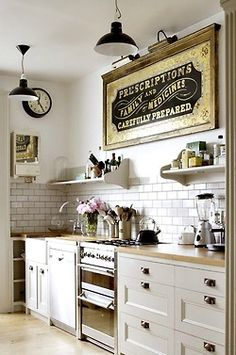 ♥sign, clock, wood counter tops, subway tile, #coolkitchen