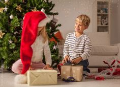 Kids Opening Christmas Presents at Home by Mosuno - Child, Christmas - Stocksy United