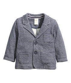 Fine-knit jacket in cotton with buttons at front, a chest pocket, and front pockets.