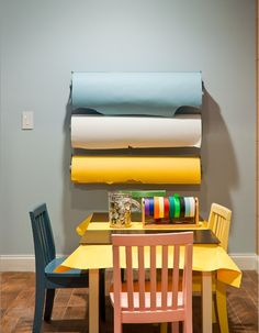 Covering tabletops in a work area is a must; we recommend multiple types (and colors!) of paper.