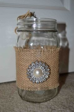 Mason jar with burlap wrap. ☺