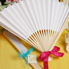 "Your guests will cool off at your beach wedding with these personalized paper hand fans.  They are a great bridal shower gift also.  Made of heavy paper with natural bamboo ribbing they measure 10"" x 18"" (open) and are available in a variety of colors."
