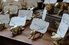 gold animal place cards and quirky calligraphy