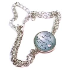 Quoting Proverbs 31, this beautiful, bright metal chain has a glass dome charm that reads, 'She is clothed in strength and dignity.' Measuring 7 inches with a 3-inch extender, this bracelet will fit any wrist to remind a woman of her strength and beauty.