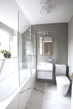 Small bathroom does not have to be boring. One of my favorite bathroom projects! … Small bathroom doesn't need to be boring. One of my favourite bathroom projects! Love the combination of herringbone and marble effect tiles in this bathroom, which togethe Modern Bathroom Design, Bathroom Interior Design, Ideas Baños, Decor Ideas, Decorating Ideas, Tile Ideas, Gray And White Bathroom, White Shower, Bathroom Flooring