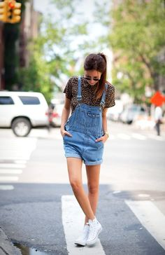 Shop this look for $67: http://lookastic.com/women/looks/brown-silk-shirt-and-white-high-top-sneakers-and-blue-overall-shorts/881 — Brown Leopard Silk Shirt — White High Top Sneakers — Blue Overall Shorts