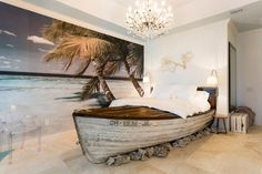 One of two master bedrooms, this island-themed space features a king-size bed nestled within a ship frame atop a smattering of rocks.