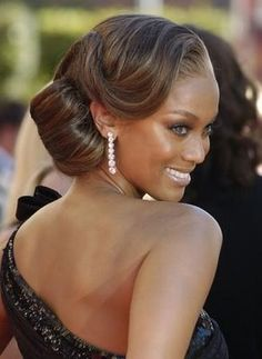 Love Tyra Banks elegant hair do. Reminds me of the 1940's glamour. via Great wedding hairstyles.com