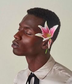 Adonis Bosso is wearing flowers in his hair for you.
