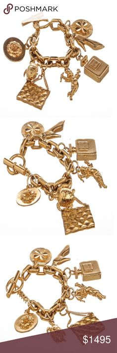 """Chanel Vintage Gold 7 Icon Dangling Charm Bracelet Chanel Vintage Gold 7-Icon Dangling Charm Bracelet with a four-leaf clover, high heel pump, Chanel No. 5 perfume bottle, angel, quilted """"CC"""" classic handbag, turtle, and camellia and a toggle closure.  Box included.  Shop AUTHENTIC Chanel jewelry at MARQUE SUPPLY COMPANY.  2816MSC Chanel Jewelry Bracelets"""