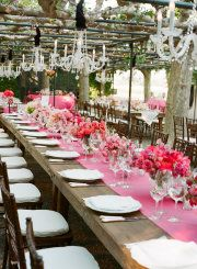 Pink runner with pink floral. Long Kings tables with chandeliers