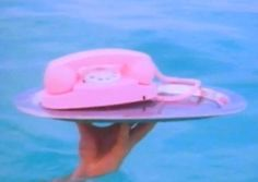 Business by the pool in summertime. #pool #phone #pink