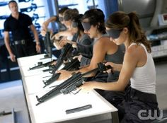 Learning how to put a gun together with a blind fold over their eye's