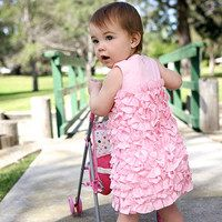 RuffleButts celebrates how quickly a moment can become a memory by creating timeless, frilly designs that reflect the magic of childhood. Home to the original ruffled bloomer, RuffleButts is known for their high-quality fabrics and impeccable craftsmanship. By affixing frills to every style, they're able to emulate a girl's natural charm: It's the flounce that counts!
