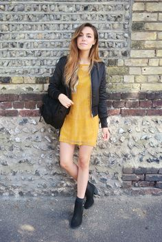 "Marzia Bisognin - or maybe you know her as YouTube's ""CutiePie"" - shows us one of her H&M back-to-school looks. Satin black pilot jacket, golden yellow lace dress, faux suede backpack, and heeled ankle boots available in select stores & on hm.com. 