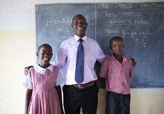 Teacher with students (8-9) in Primary School, Maasai area, Kenya