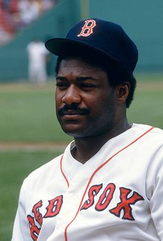 Don Baylor of the Boston Red Sox looks on from the dugout during an Major League Baseball game circa 1986 at Fenway Park in Boston Massachusetts...