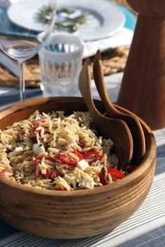 The morning before the party, whip up this orzo pasta salad to let the red wine vinegar dressing soak into all the ingredients. We especially love this side because it tastes best at room temperature and highlights seasonal tomatoes. Photo: Anna Monette Roberts