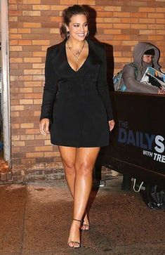 40879f2e04b Ashley Graham Wearing a Little Black Dress with Long Sleeves and Deep  V-Neck. The Curvy Fashionista