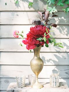 #vase, #floral-arrangement, #red  Photography: D'Arcy Benincosa - www.slcutahweddingphotography.com/  Read More: http://www.stylemepretty.com/living/2014/07/25/backyard-bridal-shower/