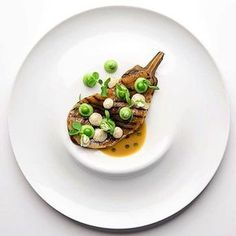 Grilled eggplant, vadouvan brew, peas & coriander. Incredible dish uploaded by @n.henkel #gastroart