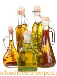 Don't use fresh herbs. Herb Oils and Flavored Vinegars in The Tasteful Garden Flavored Olive Oil, Flavored Oils, Infused Oils, Herbal Oil, Kraut, Food Gifts, Olives, Vinegar, Herbalism